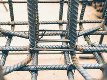Vintage style photo of selective focused steel rods in reinforced concrete footing and column Royalty Free Stock Image