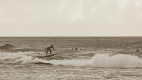 Vintage style photography of young surfers.  Royalty Free Stock Photos