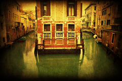 Vintage style picture of a canal and old buildings in Venice. Vintage textured picture of a canal around old buildings in Venice, Italy Royalty Free Stock Photography