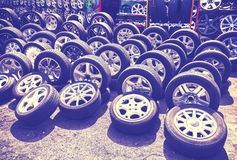 Vintage style picture of car wheels and aluminum rims. Stock Image