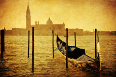 Vintage style picture of a gondola in the lagoon of Venice Royalty Free Stock Photo