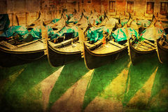 Vintage style picture of gondolas in Venice in a row Stock Image
