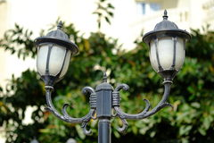 Vintage style picture with old street lamp in the park Royalty Free Stock Image