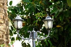 Vintage style picture with old street lamp in the park Stock Images