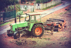 Vintage style picture of old tractor used in timber industry. Stock Photos
