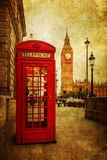 Vintage style picture of a phone box and Big Ben in London. Vintage style picture of a red phone box in front of the Big Ben in London, England Royalty Free Stock Image