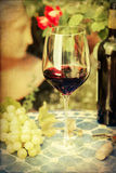 Vintage style picture of a still life with wine Royalty Free Stock Photo