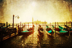 Vintage style pictures of a gondola landing in Venice Royalty Free Stock Image