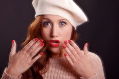 Vintage style portrait of beautiful young woman wearing a beret hat. Stock Image