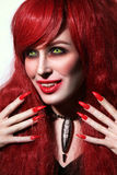 Vintage style portrait of young beautiful redhead woman with got. Hic Halloween make-up and fangs royalty free stock photo
