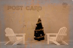 Vintage Style Postcard. Chairs on Beach With Christmas Tree, Vintage Style Postcard Stock Photo