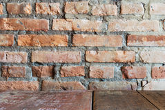 Vintage style. Red brick wall with wood table Royalty Free Stock Photography