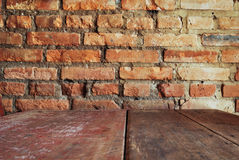 Vintage style. Red brick wall with wood table Stock Photography