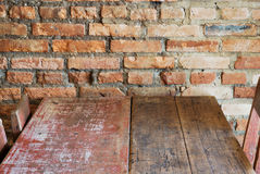 Vintage style. Red brick wall with wood table Royalty Free Stock Photo