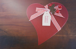Vintage style red heart shape Christmas gift Stock Photography