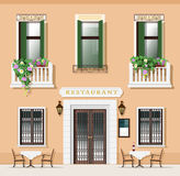 Vintage style restaurant facade. Old-fashioned cafe with tables and chairs. Stock Photo