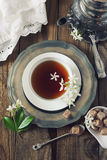 Vintage style: romantic tea drinking with jasmine tea. Decorative composition of vintage style: romantic tea drinking with jasmine tea. Toned image Royalty Free Stock Photo