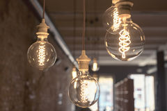 Vintage style round light bulbs hanging from the ceiling Stock Photography