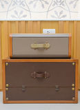 Vintage style rubber chest box in room Stock Photography