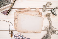 Vintage style rustical mockup with sheet of old blank paper on a wooden texture Royalty Free Stock Photo