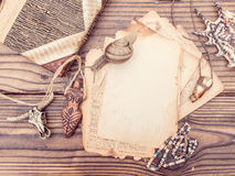 Vintage style rustical mockup with sheet of old blank paper on a wooden texture Royalty Free Stock Image