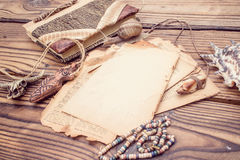 Vintage style rustical mockup with sheet of old blank paper on a wooden texture Stock Photo