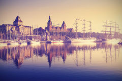 Vintage style sailing ships at sunrise in Szczecin. Royalty Free Stock Photos