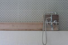Vintage style shower head set on wooden shelf above over bathtub in outdoor bathroom. Selective focus stock images