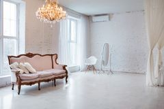 Vintage style sofa in loft interior room with big window. Vintage style sofa in loft interior room with big window Royalty Free Stock Photo