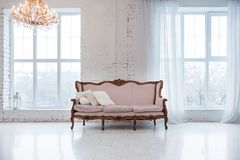 Vintage style sofa in loft interior room with big window. Vintage style sofa in loft interior room with big window Royalty Free Stock Photos