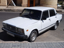 Vintage style, a soviet white car. Old Soviet white car in Bukhara, Uzbekistan - vintage style in Silk Road Royalty Free Stock Photo
