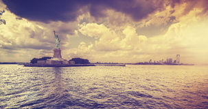 Vintage style Statue of Liberty with dramatic sunset, New York. Stock Photos