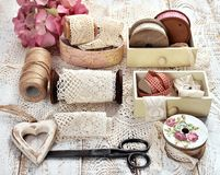 Vintage style still life with lace trim spools and accessories Royalty Free Stock Images