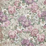 Vintage style of tapestry flowers pattern on wooden background Royalty Free Stock Image