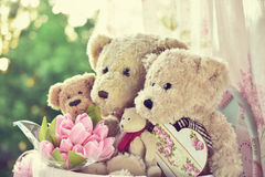 Vintage style teddy bear family siiting in the window Royalty Free Stock Photography