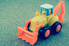 Vintage style tractor backhoe toy Royalty Free Stock Image