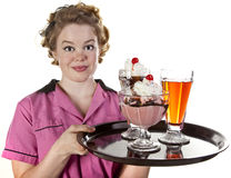 Vintage Style Waitress Serving Ice Cream and Sodas Royalty Free Stock Photography