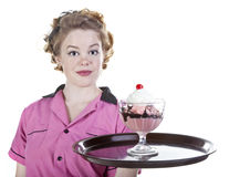 Vintage Style Waitress Serving an Ice Cream Sundae Royalty Free Stock Photography