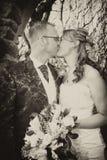 Vintage style wedding couple. Vintage style wedding photo of a couple kissing Stock Photography