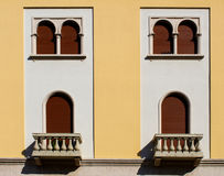 Vintage style windows on a building facade. Front view Royalty Free Stock Photo