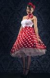 Vintage style - Woman is the vintage room in polka dots clothes Stock Photography