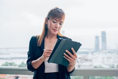 Vintage style, Young business woman with tablet in the office ag. Vintage style, Portrait of a beautiful Chinese business woman in smart business suit. Asian Stock Photos