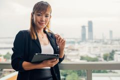 Vintage style, Young business woman with tablet in the office ag. Vintage style, Portrait of a beautiful Chinese business woman in smart business suit. Asian Royalty Free Stock Image
