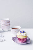 Vintage styled cupcake in purple Stock Photo