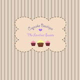 Vintage styled cupcake store card. An adorable vintage retro sticker on a striped beige pastel background with cupcakes and a heart for a pastry boutique or Royalty Free Stock Image