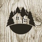 Vintage styled eco house badge with tree on wooden texture backg Stock Photos