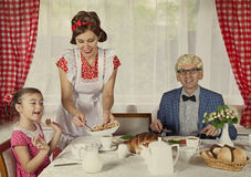 Vintage styled family have breakfast Stock Photos