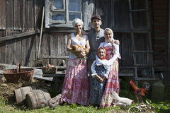 Vintage styled family portrait with some hens Stock Image