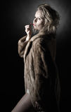 Vintage Styled Girl in Fur Coat Royalty Free Stock Photography