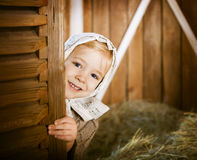 Vintage styled photo of little girl in farm Stock Images